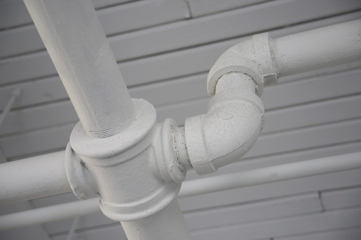 Close up image of white pipes for plumbing blog post Trenchless pipe relining how does it work