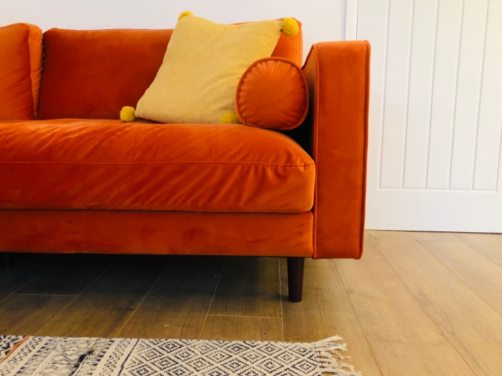 orange sofa white walls