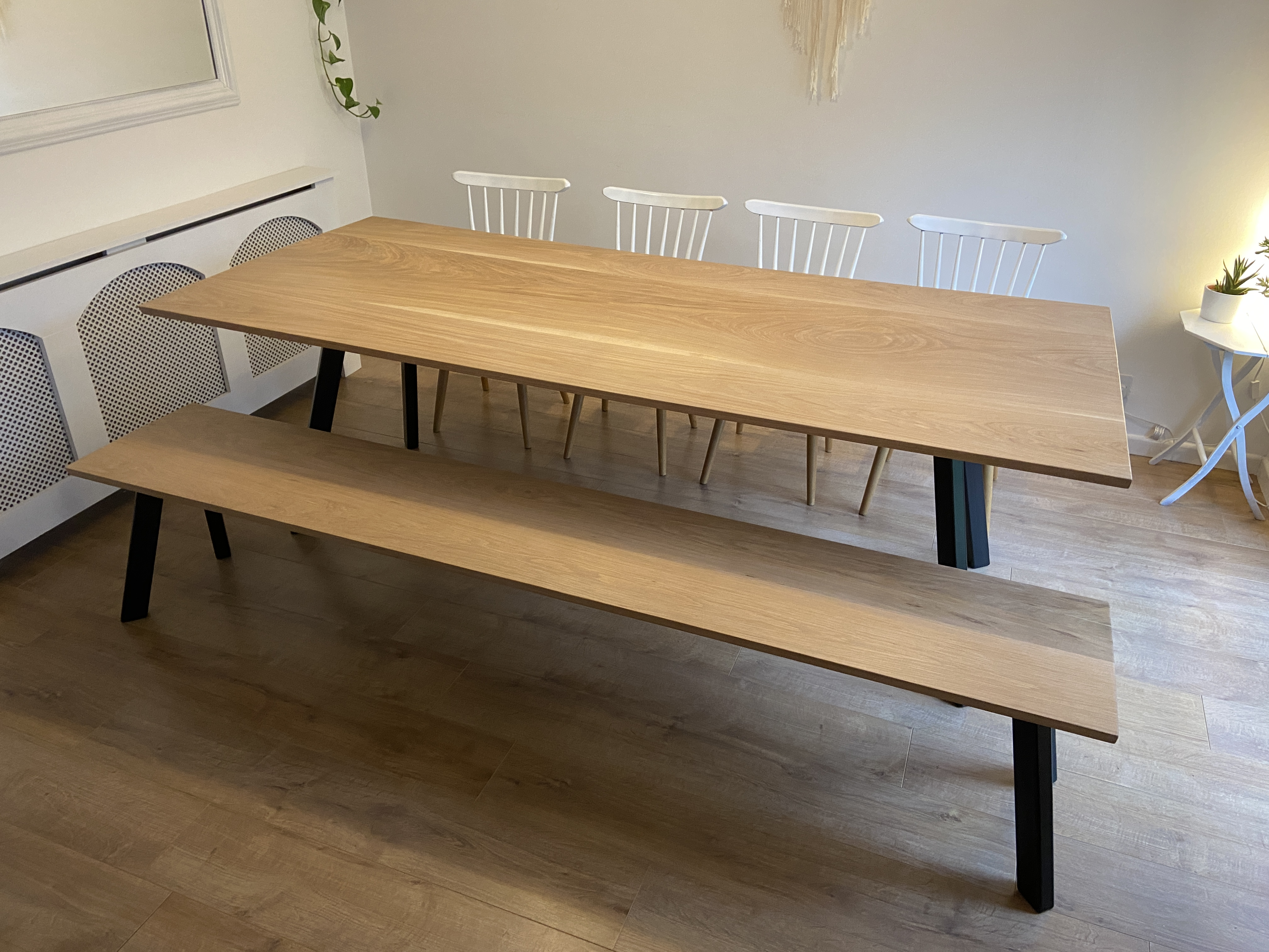 White oak dining table with steel splayed legs